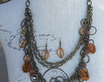 Long necklace and brown beads and antique brass chain multi strand. Great Christmas gift