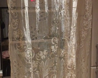Pair of blond lace curtains in good condition