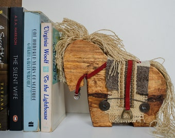 Wooden horse with textiles and rustic details