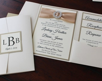 Ivory and Champagne Metallic Himalaya Pocketfold Wedding Invitation with Monogram Fastening Label; circular rhinestone buckle