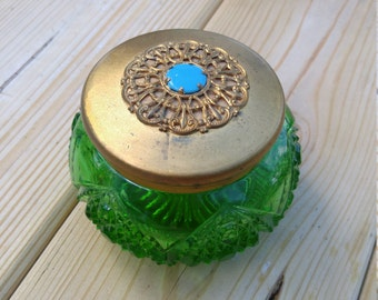 Vintage Green Vanity Jar. Gold lid with blue accent.