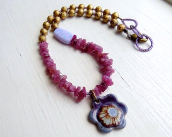 Peony - handmade colourful bohemian necklace with artisan beads with floral detail in pink, gold and purple - Songbead Uk, narrative jewelry