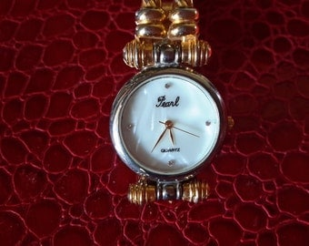 Vintage Pearl Quartz Ladies Watch Roped Gold Tone and Silver MOP Made In Hong Kong Wonderful Working Condition