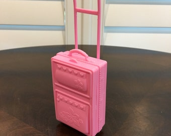 Pink Barbie Size doll suitcase with molded wheel detail