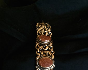 Vintage bracelet gold glitter confetti copper bronze oval ornate setting jewelry bargain