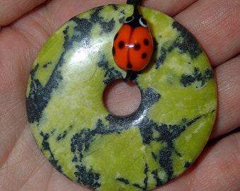 Large Yellow Turquoise Donut Pendant with Glass Ladybug on Leather.