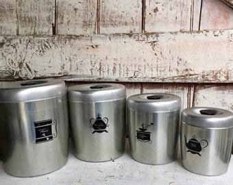 Aluminum Canister set with black lids set of 4 Coffee, Tea, Flour, Sugar West Bend vintage