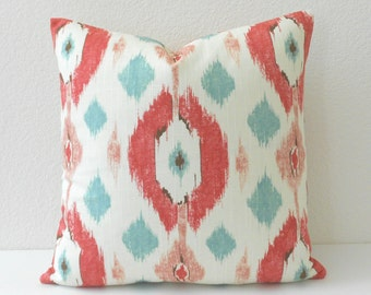 Double sided, aqua and coral multicolor geometric ikat decorative pillow cover