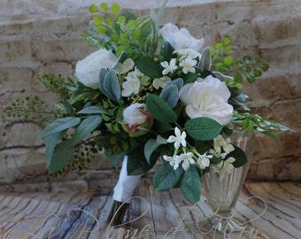 Wild, loose on trend garden wedding bouquet.  White flowers and lush foliage.  Boho inspired garden bouquet.