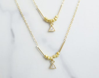 Short dainty triangle trillion pendant necklace with gold nuggets