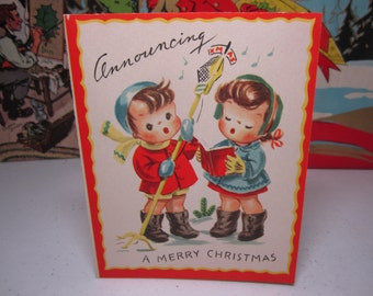 Sweet 1948 colorful Whitman christmas card little boy and girl singing christmas carols into xmas radio station microphone