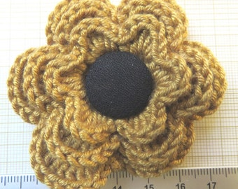 Irish crochet flower brooch in mustard wool with black button centre