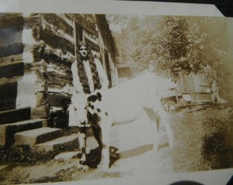 Vintage Snapshot Photo - Long Dark Hair Girl Posing With Cow