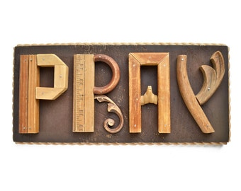 PRAY sign, original sign, typography, mixed media assemblage, carved wood hands, architectural salvage,  by Elizabeth Rosen