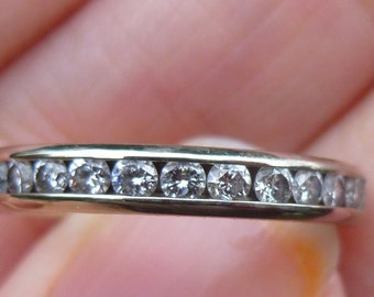 Round Brilliant Diamond eternity band -- approximately 1 ct tw 14KT  White gold  Diamonds all the way around  Full cut diamonds  Size 6.25