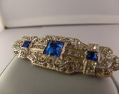 Silver and Sapphire Brooch w/Emerald cut stones