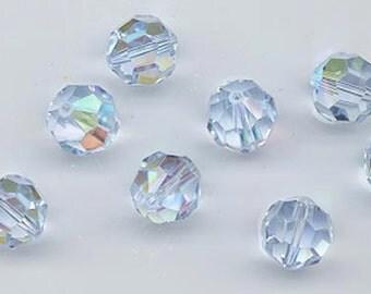 Twelve Swarovski crystals in the non-standard color alexandrite AB - Art. 5000 - 10 mm