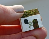 Tiny wooden house, sculpture, whimsical, white house, moss,  terrarium, Ireland, cottage, white and green, home