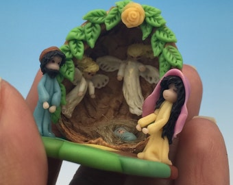 Miniature Nativity,Mary ,Joseph and babyJesus.nut shell.