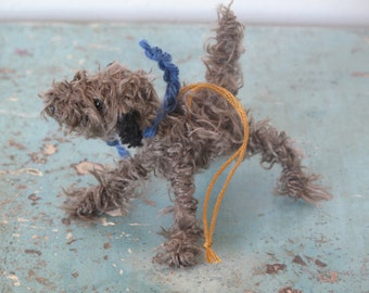 Scruffy brown dog with black ears decoration.