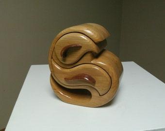 "Sculpted Jewelry Box. 8.5""H x 7.5""W x 5.25""D."