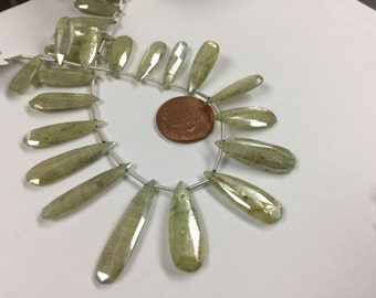 Coated Green Kyanite Pears Faceted