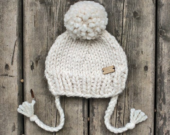 Cream chunky knit baby hat with pom-pom & ties