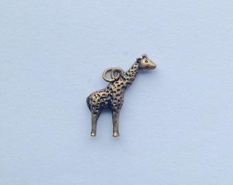 Tiny giraffe charm