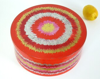 Ira Denmark tin, red with  silver and gold sunburst, designed by Anita Wangel