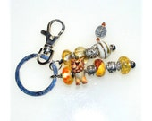 "Beaded Key Ring with Whimsical Lion and ""Courage"" Charm"