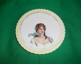 "One (1), 6 1/4"" Porcelain, Portrait Center, Plate, from Sterling China, USA."