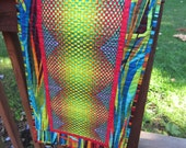 Quilted table runner.  Brightly colored fabrics.
