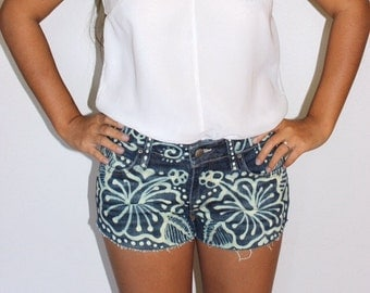Upcycled denim shorts with hibiscus design