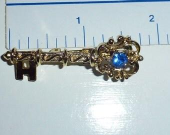 Vintage Rhinestone Key Brooch/Pin with Blue Rhinestone and Filigree Design