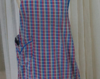 Blue plaid bib apron with ruffle trim and pocket. Full coverage, 1970s, 1960s, cookout, tailgate, kitchen
