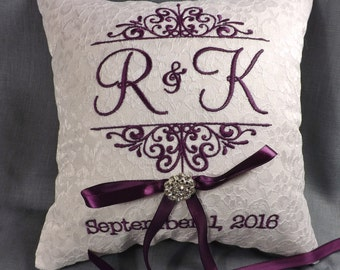 Initial embroidered ring bearer pillow.  White linen with purple thread.
