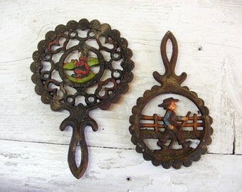 Set of Two Vintage Cast Iron Amish Trivets
