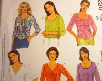 Really Cute McCalls Womens pullover shirt pattern with Three-Quarters Length Sleeves: Large and Extra Large