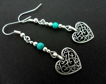 A pair of hand made tibetan silver & turquoise bead dangly heart earrings. new.