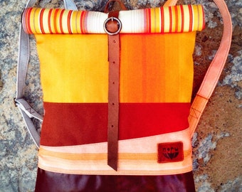 Cardamon bag, waterproof rolltop bike backpack, upcycled canvas, yellow, striped, rust brown, peach blossom. Recycled cow leather bottom.