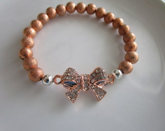 Rose pink gold colored clear bejeweled bow bracelet - bow jewelry, rose gold bracelet, pink gold bracelet, bow charm bracelet, rose bow
