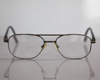 Vintage APOLLO-OPTIK eyewear, Silver Frame,   Black Temples, Clear Lenses RX Prescription . Rare Piece. Made in Austria