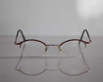 Vintage GMC, TREND COMPANY Eyewear, Gold Half Rimless Frame, Black Temples, Rx-Able Prescription lenses . Rare Piece. Made in Germany
