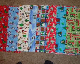Eight 18 x 24 Inch Peanuts/Snoopy Christmas Cotton Fabric Remnants
