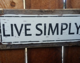 "Recycled wood framed ""Live Simply"" street sign"