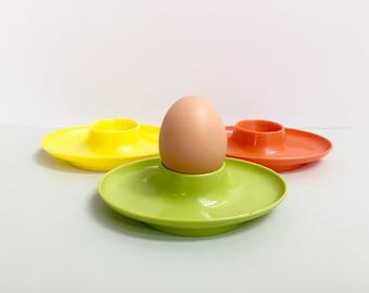 Plastic egg cups, set of three