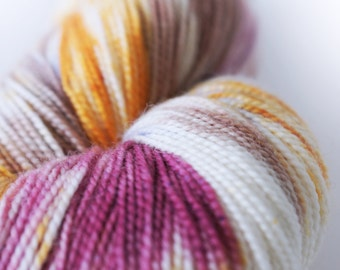 "Hand Dyed Yarn Superwash Merino . Fingering . 440 yards . 100 g . Wild Lilac Moon's Lilac Dream in ""Potpourri"". brown magenta orange white"
