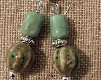 Green porcelain earrings that match necklace show.