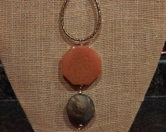 Suede cord with brass and carnelian pendant