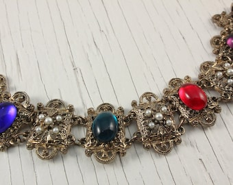 Vintage Gold Tone Link Bracelet with Faux Pearl Accents and Purple Red Blue and Green Cabochons (retro 50s 60s plastic filigree royal boho)